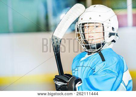 Little Hockey Player In Helmet And Blue Uniform