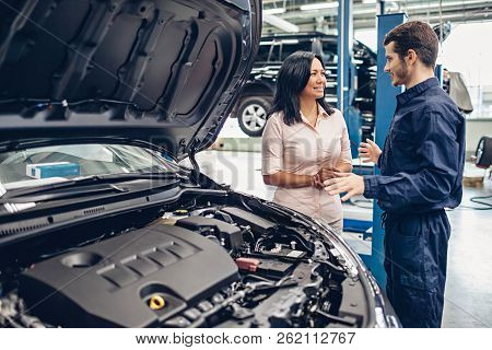 Car Service Center Scene. The Mechanic Communicates With The Client