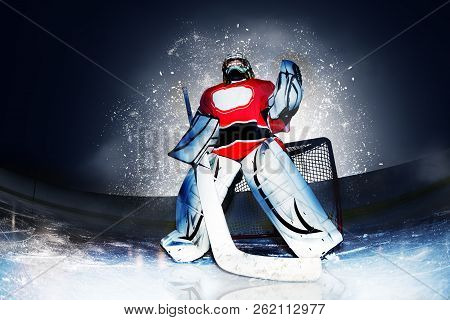 Goaltender At Hockey Arena In Searchlight Rays