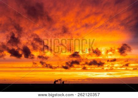 Fiery Orange Sunset Sky. Beautiful Sky.red Sunrise Sun Over Cityscape.dramatic Red Yellow Sunset Ove