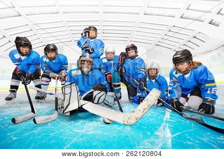 Portrait Of Children's Hockey Team At Ice Arena