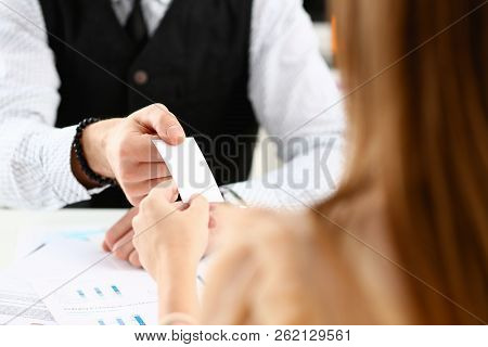 Male Hand In Suit Give Blank Calling Card To Female Visitor Closeup. White Collar Partners Company N