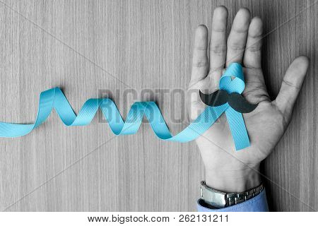 Prostate Cancer Awareness, Man Hand Holding Light Blue Ribbon With Mustache For Supporting People Li