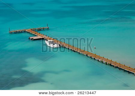 Caribbean boat pier at a resort hotel in cancun mexico on the blue ocean water