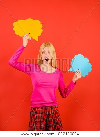 Surprised Girl Hold Speech Bubbles. Amazed Woman With Text Bubbles. Beautiful Girl Shows Sign Speech