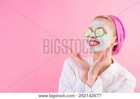 Happy Woman With Mask On Face. Beauty Treatments. Facial Clay Mask. Spa. Cosmetic Mask. Beauty Mask.