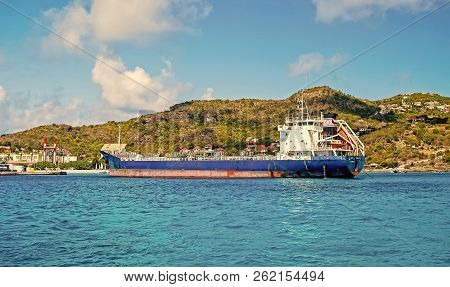 St. Barts - January 01, 2016: Big Cargo Ship Or Barge Blue Color In French Island Bay Of Saint Barth