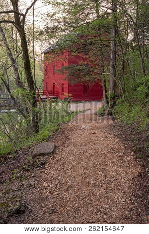 Red Mill Barn At The End Of Hiking Trail Along Side A Stream, Old Grist Mill