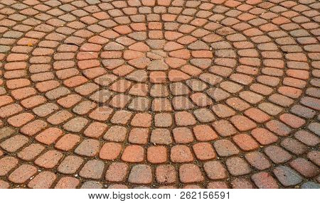 Red Circular Paved Bricks With Dirty Moss And Worn Age