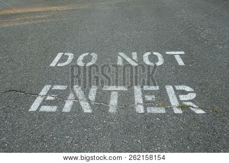 Stenciled Painted Lters On Road Pavement Asphalt Do Not Enter