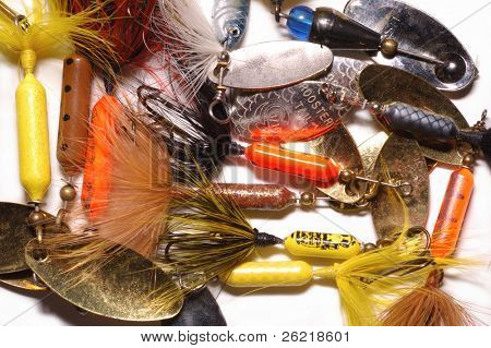 Heap of fishing spinner baits as a background