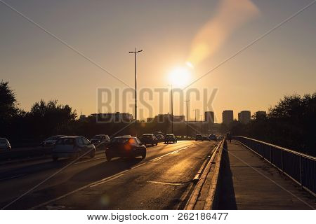 City Traffic In Sunset. Sunset On City Highway. Cars On Highway In Sunset In The City. Traffic Rush