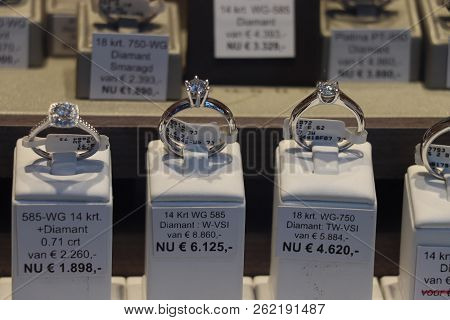 Haarlem, The Netherlands - October 6th 2018: Diamond Rings In A Shop Window. Text On Tags: Discount