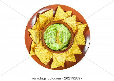 Traditional Mexican Guacamole Sauce Made From Avocado And Lime Chips Nachos On A White Background. G