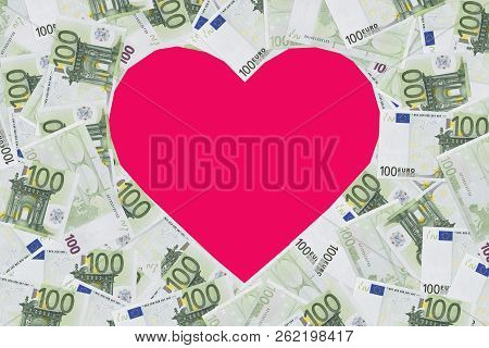 Heart Shape Sign With 100 Euro Banknotes. Valentine Concept Background. Heart Of Banknotes In 100 Eu