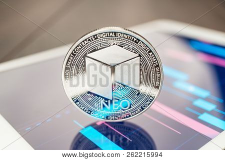 Close-up Photo Of Neo Cryptocurrency. Neo Physical Coin On The Tablet Computer. Tablet Showing Neo S