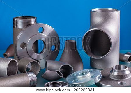 Set Of Steel Welding Fittings Like Tees, Elbows, Flanges, Reducers, Sockets, Nipples, Cups And Other