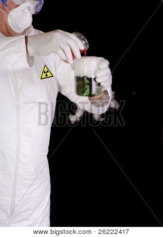chemical engineer, or nuclear scientist mixing hazardous chemicals in clean room environment