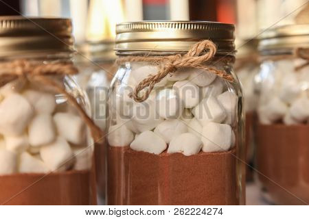 Marshmallows with chocolate mix in glass jar
