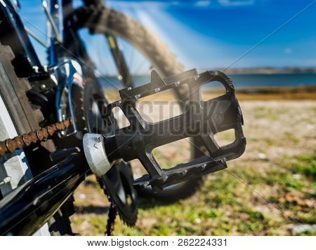 Bike pedal detail with sun beams