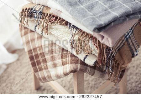 Blankets Close Up. Autumn Cozy Interior. A Stack Of Warm Blankets Lie On A Wooden Chair. Autumn. Win