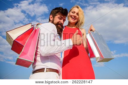 Couple In Love Recommend Shopping Summer Sale Discount Season. Couple With Shopping Bags Cuddle Blue