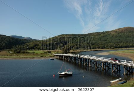 a view of penmaenpool toll bridge in snowdonia north wales. poster