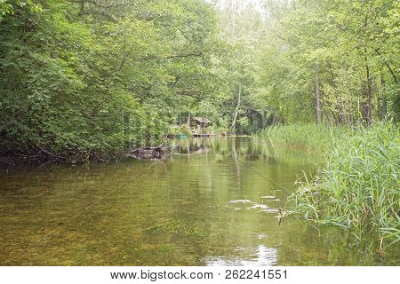 Beautiful River In A Forest. Summerhouse Near The River Bank. Lithuania, Ignalina, Meironys, Meira R