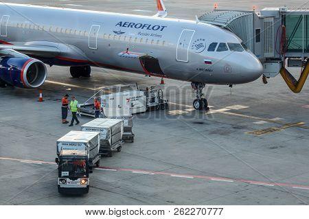 Prague, Czech Republic - July 28th, 2018: Ground Personnel Loading Baggage Cargo Into Aeroflot Airbu
