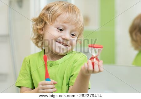 Little Cute Child Boy Brushing His Teeth In Bathroom Interior. Healthy Conception.
