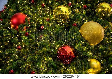 Conceptual image of decorated Christmas tree with colorful lights and ornaments