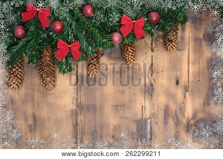Decorated Wooden Background With Christmas Tree Branches.