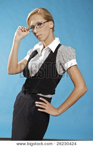 beautiful blonde businness woman portrait, holding a glasses.