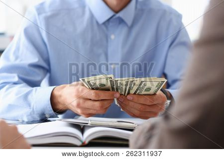 The Businessman Considers Cash Dollars In The Office Issues Salaries To Employees With Black Cash Di