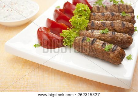 Cevapcici, A Small Skinless Sausage Cooked On The Barbecue And Served With Pickled Red Capsicum And