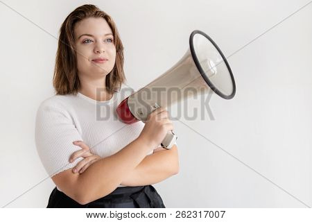 Dreamy Ambitious Businesswoman With Megaphone Looking Away. Portrait Of Proud Female College Student