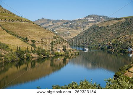Peso Da Regua, Portugal - October 05, 2018 : Boat Carrying Tourists On The Douro River, Vila Real, P