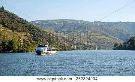 Pinhao, Portugal - October 05, 2018 : Boat Carrying Tourists On The Douro River, Vila Real, Portugal