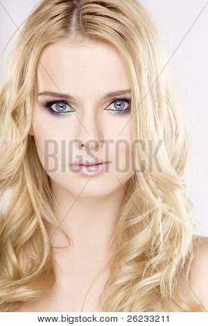 Young pretty woman with beautiful blond hairs and multicolor makeup isolated on white background poster