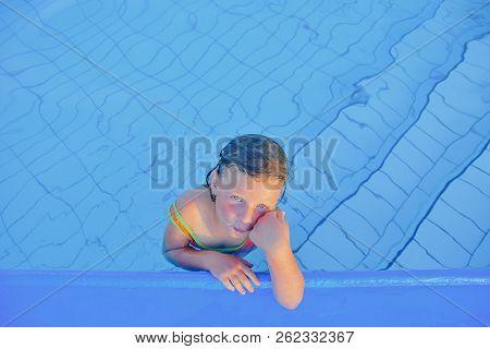 Cute Little Girl In The  Swimming Pool. Portrait Of Little Cute Girl In The Swimming Pool. Sunny Sum
