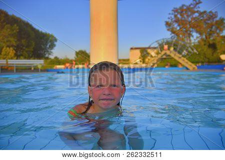 Little Girl In Swimming Pool. Portrait Of Little Cute Girl In The Swimming Pool. Sunny Summer Day. S