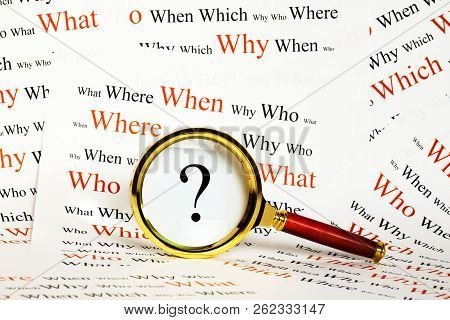 Information Or Question Concept - Magnifying Glass Over Question Mark, With A Background Of What, Wh