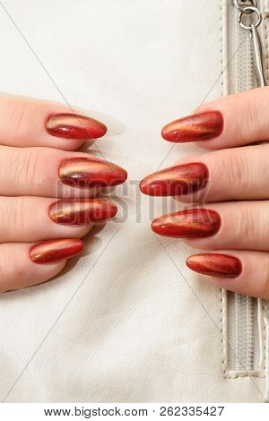 Manicure Gel Polish-red Cat Eye Nail Style On The White Background