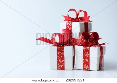 White Gift Boxes Tied With Christmas Theme Red Ribbon Isolated On White Background