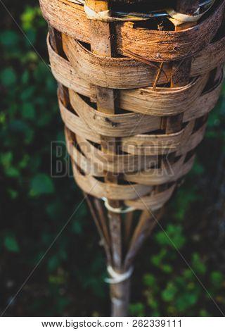 Abstract Close Up Bamboo Tiki Torch And Green Plants