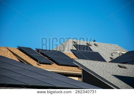 Solar Panel Rooftops On Modern Rooftops Of Homes And Houses In New Suburb Development In Austin , Te