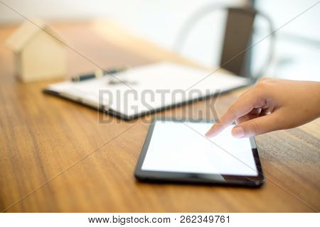 Business People Use Tablet On The Table