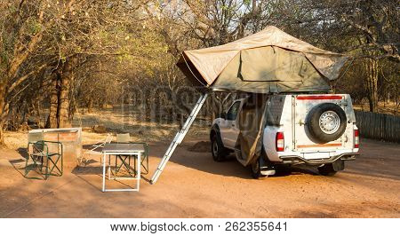 Offroad 4x4 Vehicle With Tent In The Roof Ready For Camping In The Desert
