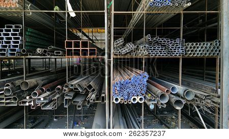 Steel Pipes Profile Stack. New Square Metal Pipes In Stock. Stack Of Steel, Steel Material. Steel Wa