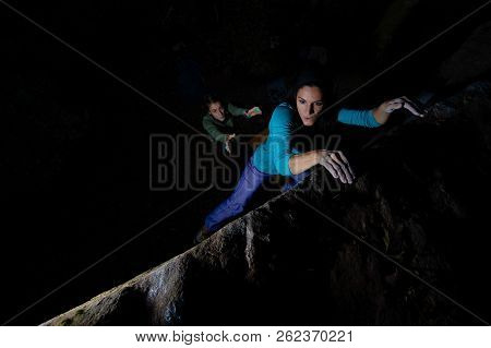 Two Girls Practice Bouldering In The Evening